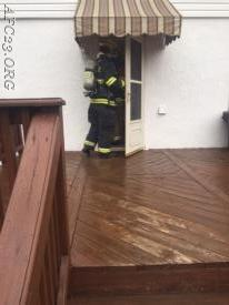 FF Wilkins making entry on the CO alarm.
