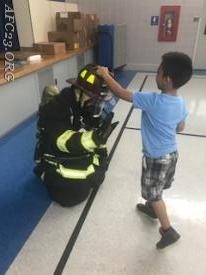 FF (Cole) giving high fives