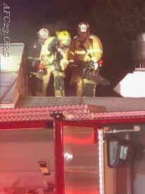 Captain Reed, Hoseman Franks, and Career Lieutenant Nuse preparing for ventilation.
