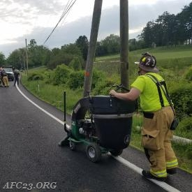 FF (B. Cole) using the new Billy Goat assisted Blittersdorfs Towing with glass removal from the roadway.