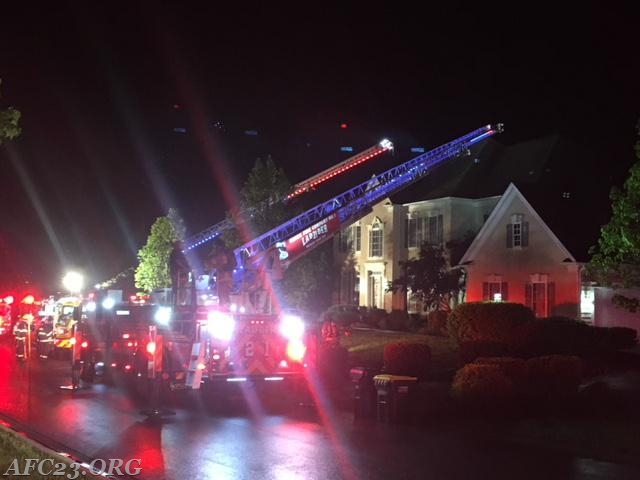 Ladder 22 and Ladder 21 set up to the roof.