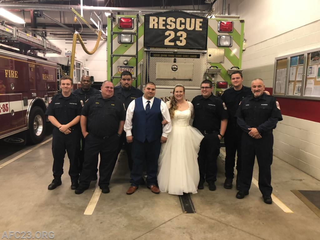 Rescue crew and the happy couple.