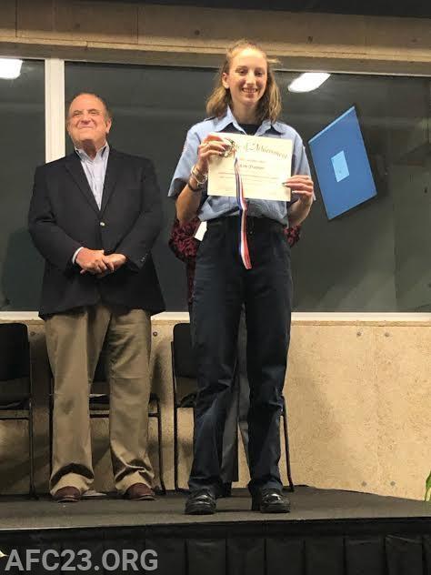 Cadet Kim Trainor receives her certificate.