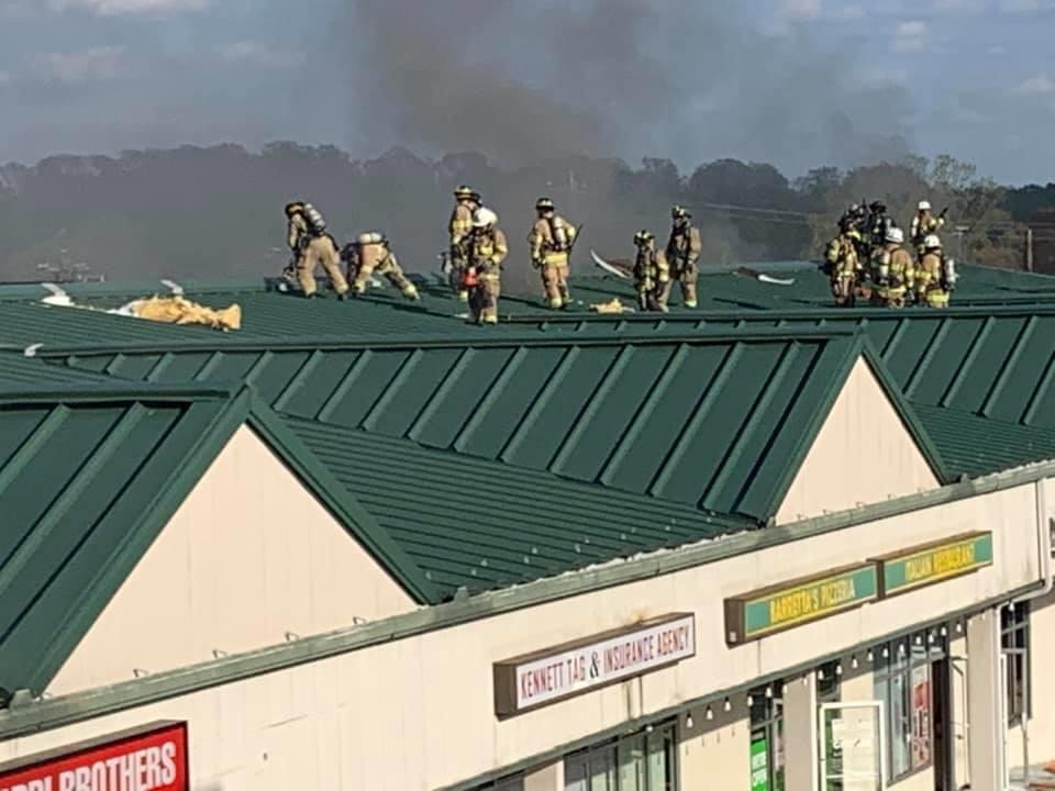 Crews operating on the roof.   Photo courtesy WGFC.ORG