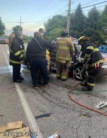 Hoseman (Cole) begins extrication.