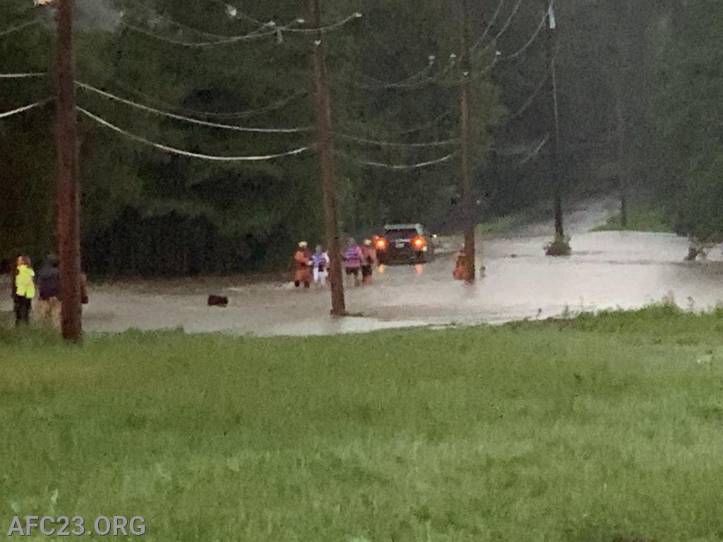 McCue Road water rescue for a vehicle that drove through flood waters and got stuck.