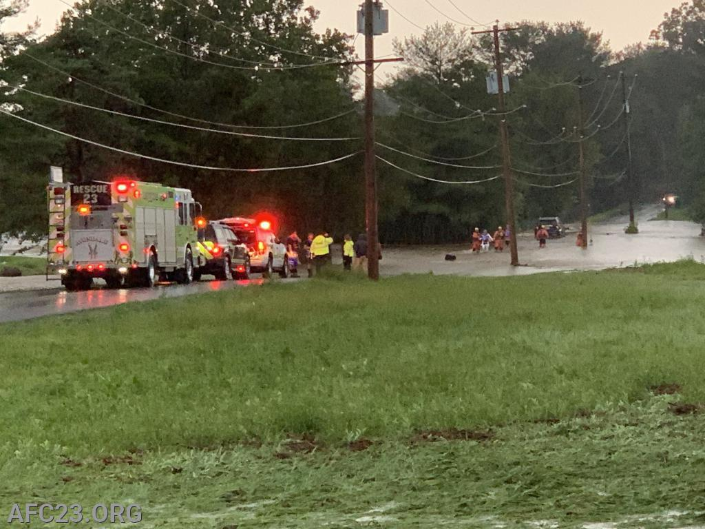 Rescue, Assistant, and Deputy 23 operating on the McCue Road water rescue.