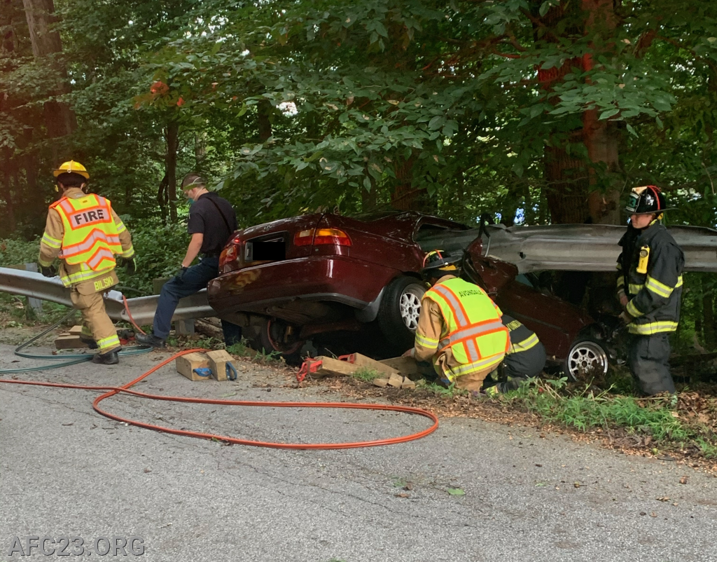Rescue crew begins to stabilize vehicle