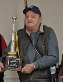 Davis in 2020 with his award for 50 years of service.