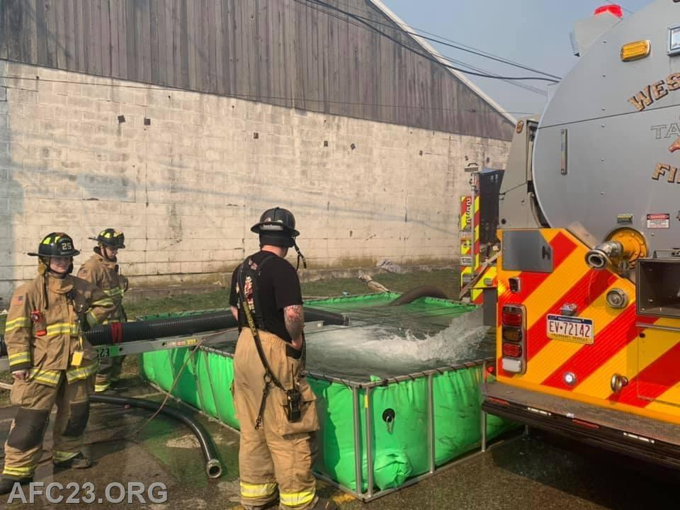 Water supply operations.   Tanker 22 dumping their water into the port-a-tank.