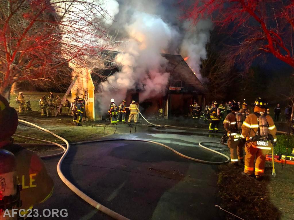 Crews work to extinguish the garage fire.