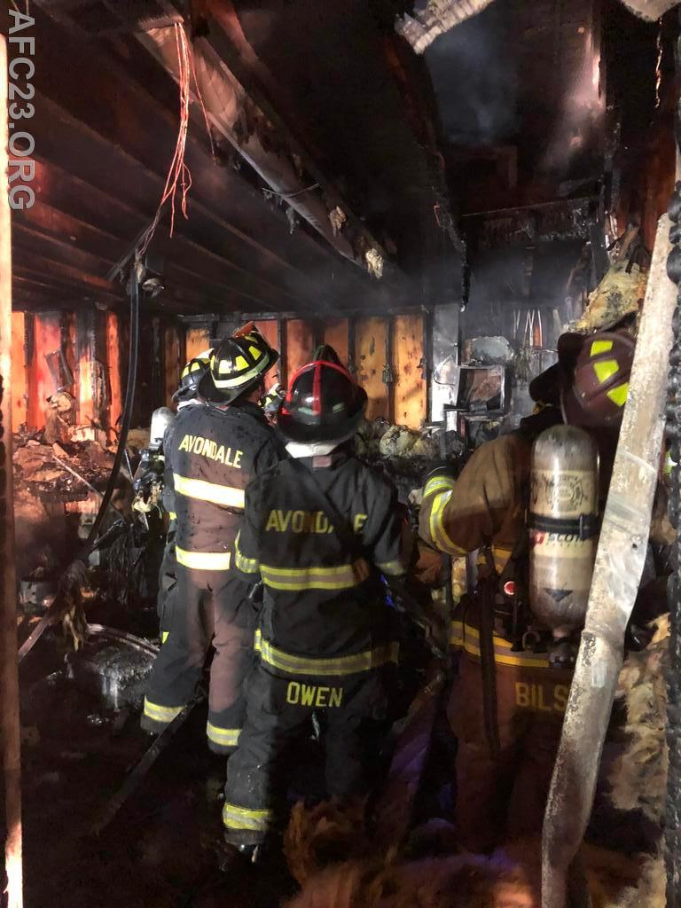 Avondale firefighters work on overhauling the garage.